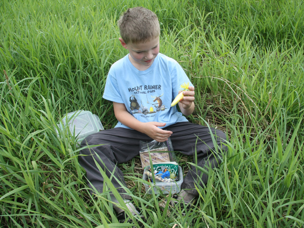 Child avidly checking Geocache